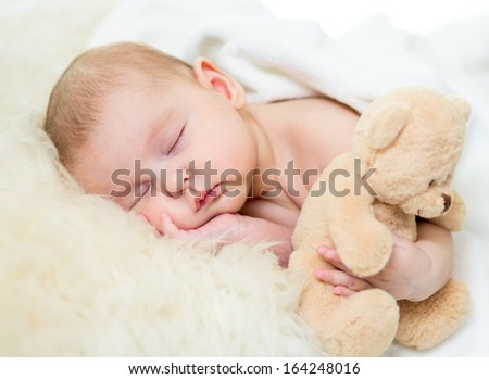 infant baby sleeping with plush toy - stock photo