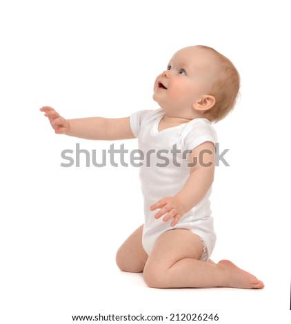 Infant baby toddler sitting hand pointing and looking up isolated on a white background - stock photo