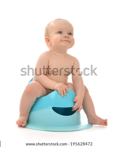 Infant child baby boy toddler sitting on potty toilet stool pot isolated on a white background - stock photo