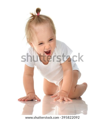 Infant child baby girl in diaper crawling happy laughing smiling looking at the camera isolated on a white background - stock photo