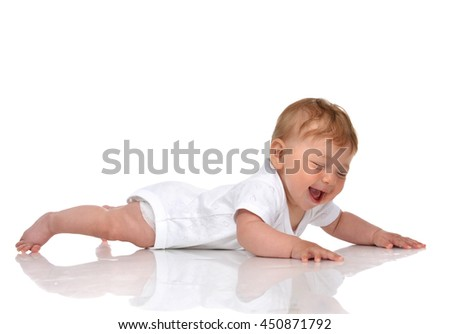 Infant child baby girl in lying in diaper happy smiling laughing and looking at the corner isolated on a white background
