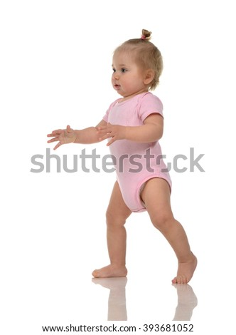 Infant child baby girl kid toddler in pink body cloth make first steps isolated on a white background - stock photo