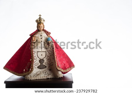 Infant Jesus of Prague in red vestments on a white background - stock photo