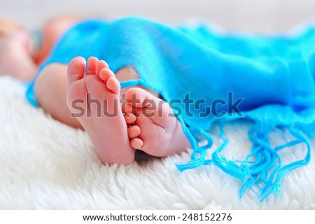Infant's small feet closeup - stock photo