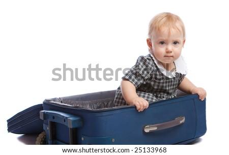Infant sitting inside the suitcase, isolated - stock photo
