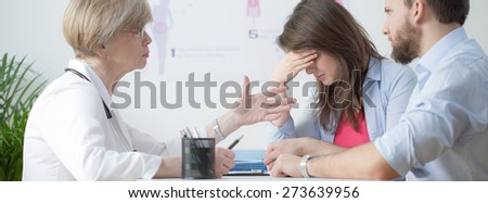 Infertile couple during control visit at gynecologist - stock photo