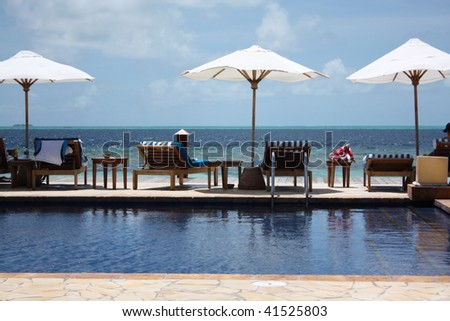 Infinity pool in a hotel resort in the Maldives - stock photo