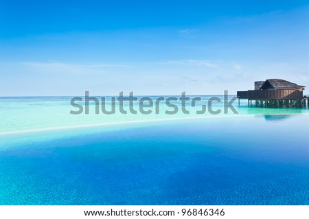 Infinity pool in the Maldives - stock photo