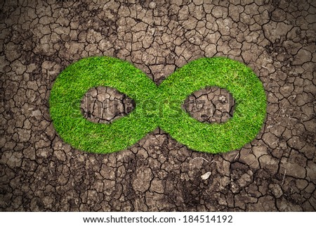 Infinity symbol in the form of a grass, against a drought  - stock photo