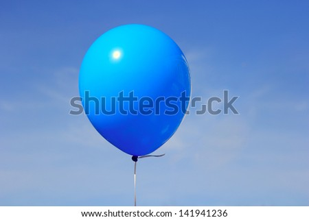 Inflatable balloon, photo on the against the blue sky - stock photo