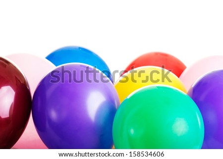 Inflatable balloons isolated on white - stock photo