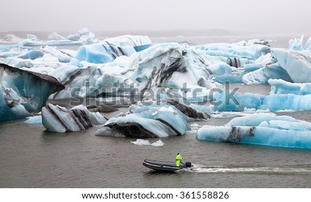 Inflatable boat in the Jokulsarlon Glacier Lagoon, Southern Iceland  - stock photo