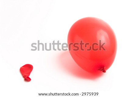 inflated and deflated balloon over white background - stock photo