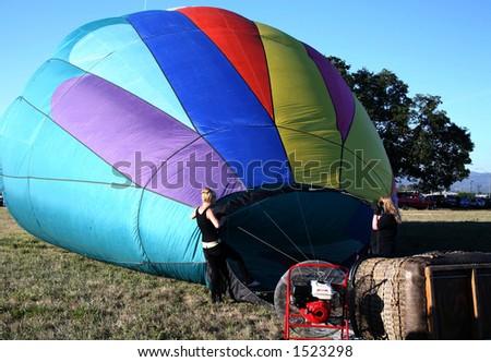 Inflating Colorful Hot Air Balloon Ride Closeup - stock photo