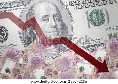 Inflation Argentine peso against the background of US dollar - stock photo