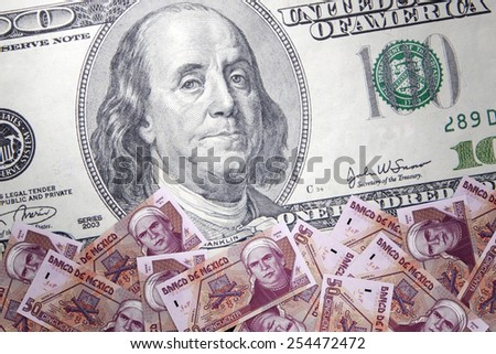 Inflation Mexican peso against the backdrop of the US dollar - stock photo