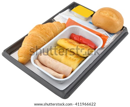 Inflight meal on a tray set, croissant, bread, meat, pepper and pancakes on a white background - stock photo