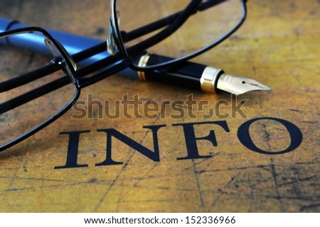 Info text glasses and pen Selective Focus, Shallow Deep Of Field - stock photo