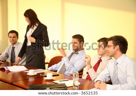 Informal business meeting of five persons - standing woman interview - stock photo