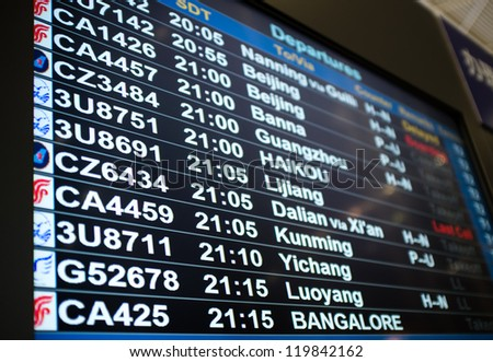 Information board in airport, In china - stock photo
