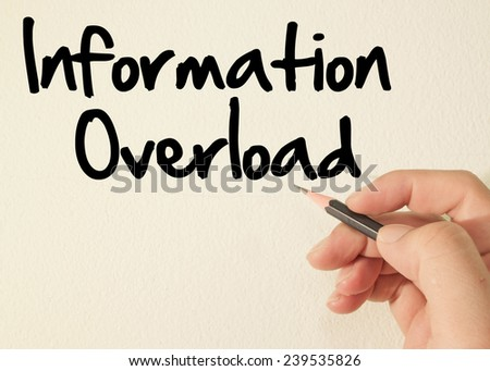 Information overload text write on wall  - stock photo