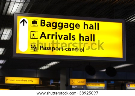 Information sign in airport. Baggage and arrivals halls directions - stock photo