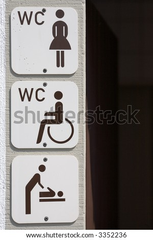 information signs on housewall for disabled, women and baby change