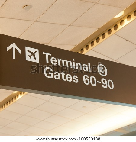 Informational sign showing gate numbers at international airport.