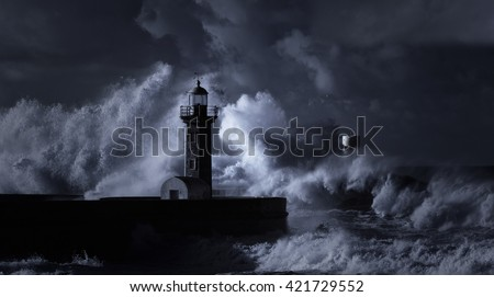 Infrared stormy seascape with huge waves against Douro river mouth old lighthouse, Porto, north Portugal. - stock photo