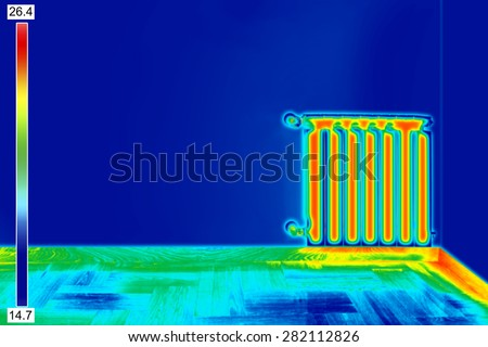 Infrared Thermal Image of Radiator Heater in room - stock photo
