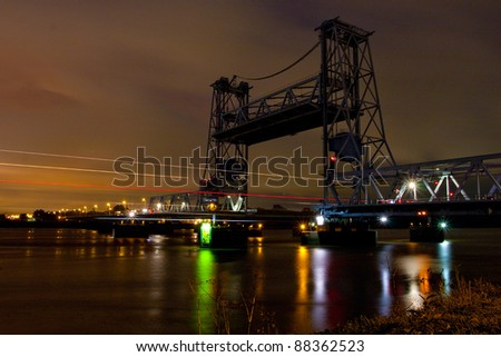 infrastructure at night in the port of Rotterdam - stock photo