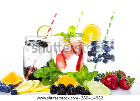 Infused water with fresh organic berries. - stock photo