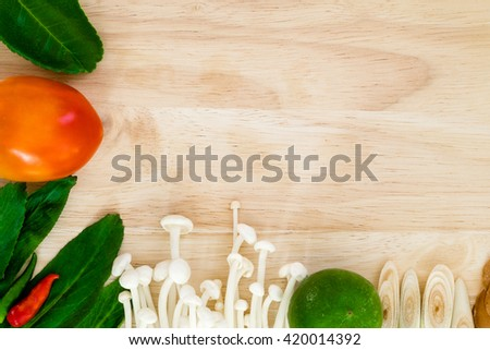 Ingredient of Tom Yum spicy soup Traditional Thai food cuisine on wood background - stock photo