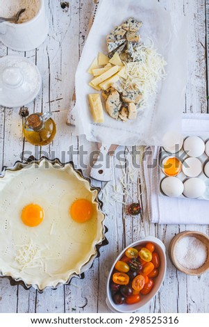Ingredients and dough for ready of quiche, pie, tart filling.  - stock photo