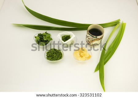 Ingredients and process of making homemade pandan tea bag for brewing hot pandan tea at convenience time with rock sugar for sweet taste and aromatic fragrance of the fresh tea. - stock photo
