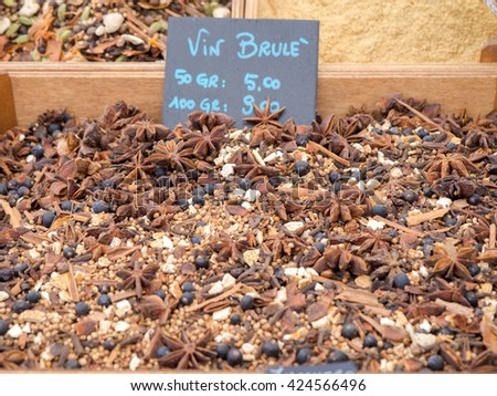 Ingredients and spices for hot wine on sale on market stall, with italian language price tag. - stock photo