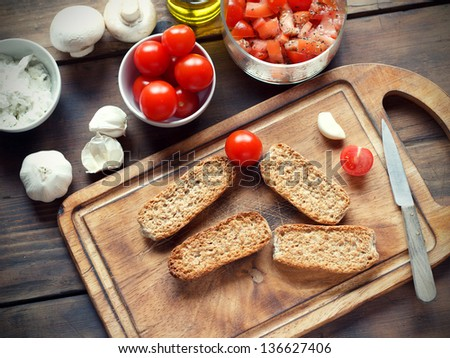Ingredients and spices on a cutting board - stock photo