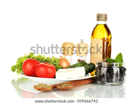 Ingredients for a Greek salad isolated on white background - stock photo