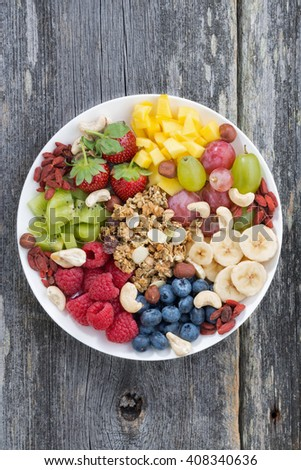 ingredients for a healthy breakfast in one dish, vertical, top view, close-up - stock photo