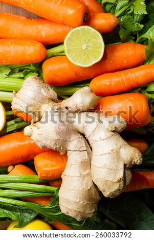 Ingredients for a healthy juice or soup: carrots, celery, lemon and ginger. - stock photo
