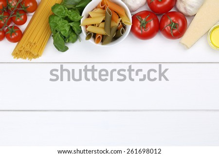 Ingredients for a spaghetti pasta noodles meal with tomatoes, basil, Parmesan cheese and copyspace - stock photo