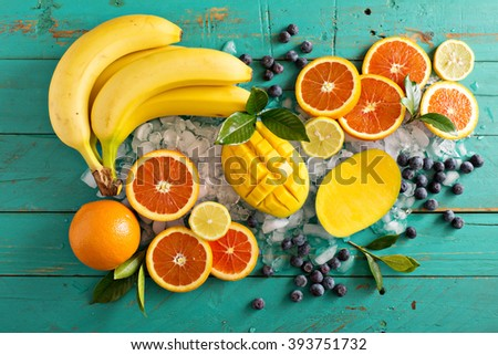 Ingredients for a tropical fruit smoothie with mango and banana - stock photo