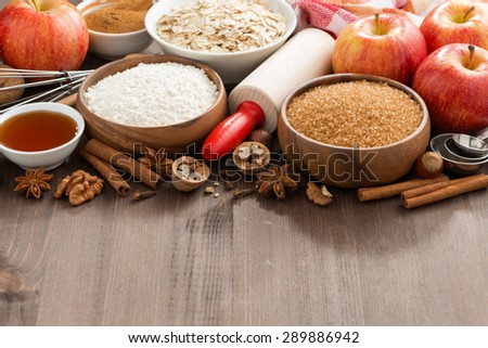 ingredients for baking cake on a wooden background, horizontal - stock photo