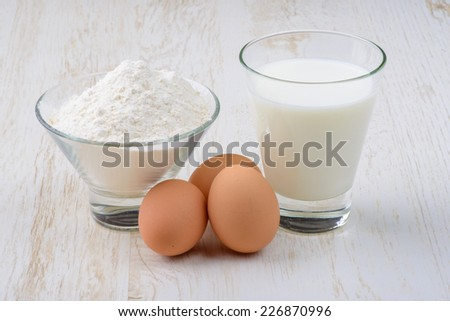 ingredients for baking, eggs, flour and milk on the table