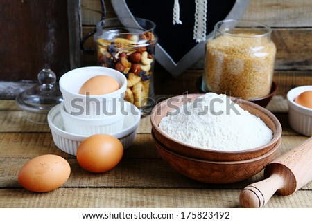 ingredients for baking, eggs, flour, nuts, food closeup