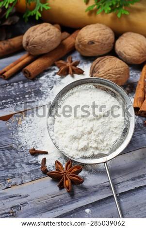 Ingredients for baking - flour, anise, cinnamon. Selective focus - stock photo