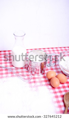 Ingredients for baking in kichen table - stock photo