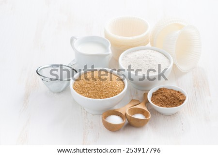 Ingredients for baking muffins on white wooden table, close-up - stock photo