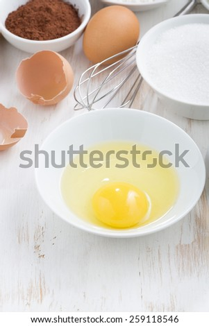 ingredients for baking on a white table, vertical, top view - stock photo