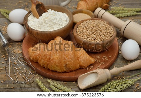 Ingredients for baking on a wooden background - stock photo